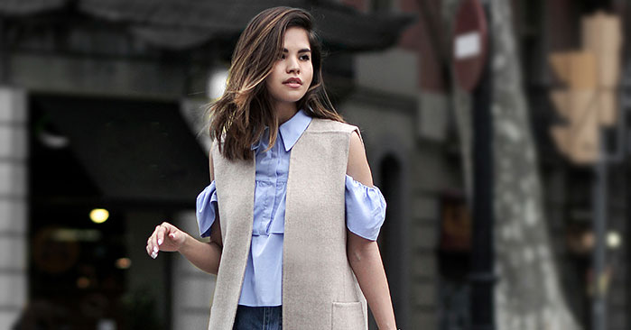 Summer Outfits - The Top Blogger Looks Of The Week: Fashion Blogger 'Fake Leather' wearing a blue off the shoulder button down top, a grey long vest, raw hem denim culottes, white mules and a white shoulder bag. Summer outfit, casual outfit, work outfit, casual friday outfit.