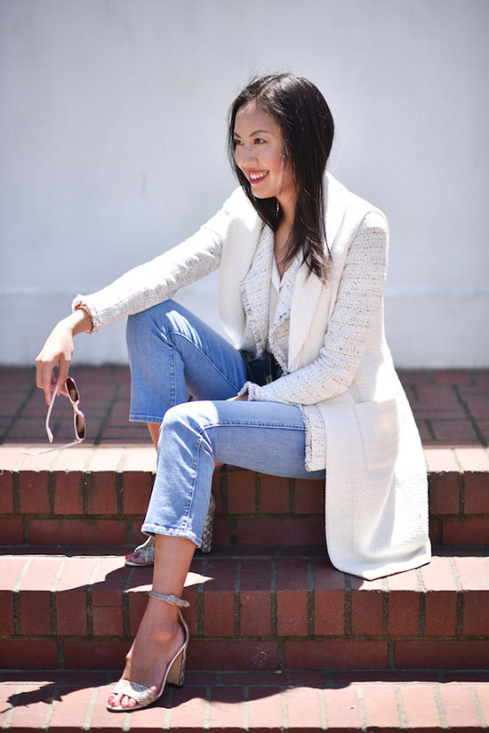 Summer Outfits - The Top Blogger Looks Of The Week: Fashion blogger '9 to 5 Chic' wearing an ivory long vest, an ivory texture jacket, a white shirt, crop jeans and snake print heeled sandals. Spring outfit, spring layers, casual outfit, street chic style.