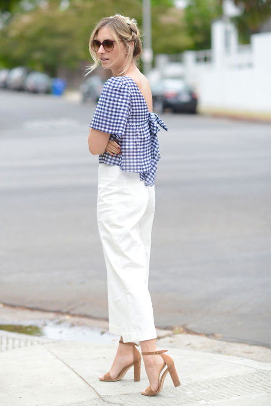Summer Outfits - The Top Blogger Looks Of The Week: Fashion blogger 'Cupcakes & Cashmere' wearing a blue gingham v-back blouse, white culottes, nude heeled sandals and brown sunglasses. Summer outfit, casual outfit, night out outfit, date night outfit, street chic style, summer trends 2016.