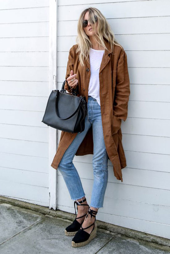 Summer Outfits - The Top Blogger Looks Of The Week: Fashion blogger 'Fashion Me Now' wearing a brown suede duster coat, a white t-shirt, crop jeans, black espadrille wedges, black aviator sunglasses and a black handbag. Spring outfit, minimal outfit, simple outfit, casual outfit, comfy outfit, street style.