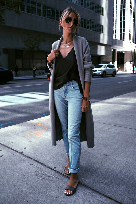 The Top Blogger Looks Of The Week: Fashion blogger 'Jetset Justine' wearing a grey long cardigan, a black v-neck cami top, light boyfriend jeans, black slide sandals and aviator sunglasses. Spring outfit, summer outfit, casual outfit, comfy outfit, summer layers, spring layers, street style.