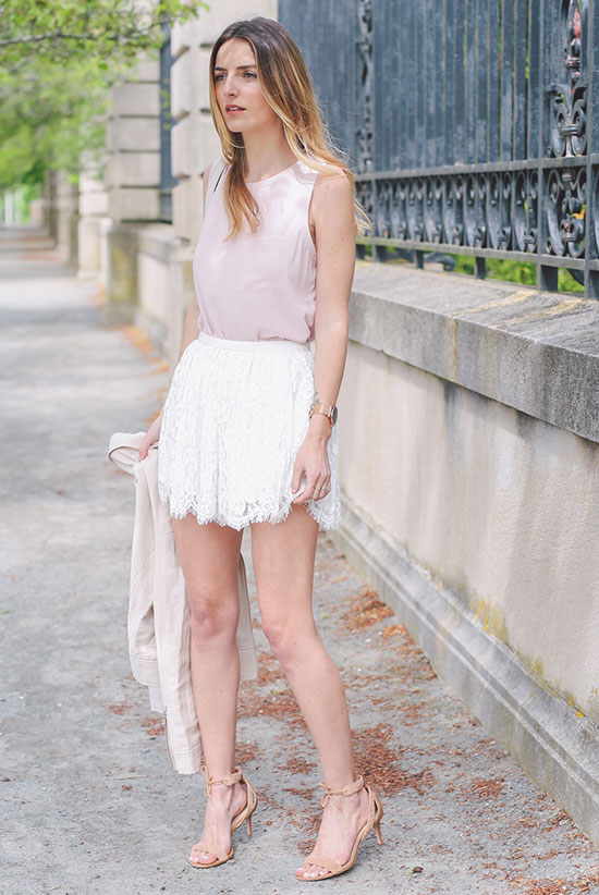 Summer Outfits - The Top Blogger Looks Of The Week: Fashion blogger 'Prosecco & Plaid' wearing a beige bomber jacket, a blush sleeveless top, white lace shorts and nude heeled sandals. Summer outfit, party outfit, night out outfit, date night outfit, street chic style.