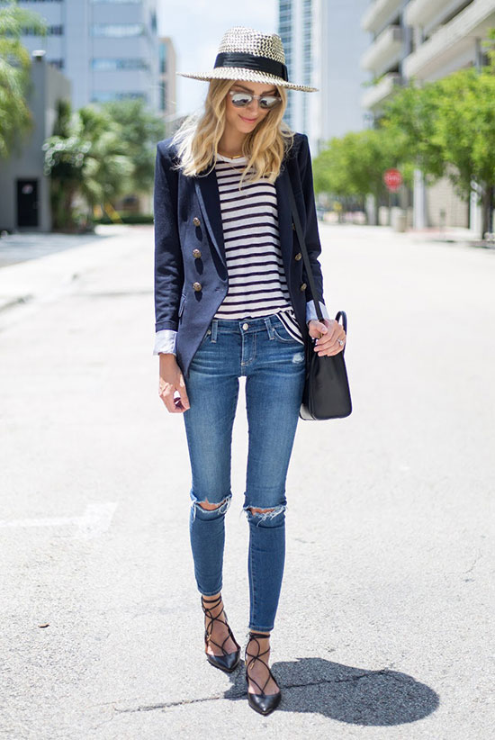 The Top Blogger Looks Of The Week: Fashion blogger 'Little Blonde Book' wearing a straw boater hat, mirror sunglasses, a navy blazer, a stripe t-shirt, distressed skinny jeans, black lace up flats and a black shoulder bag. Spring outfit, summer outfit, casual outfit, street chic style, street style, comfy outfit.