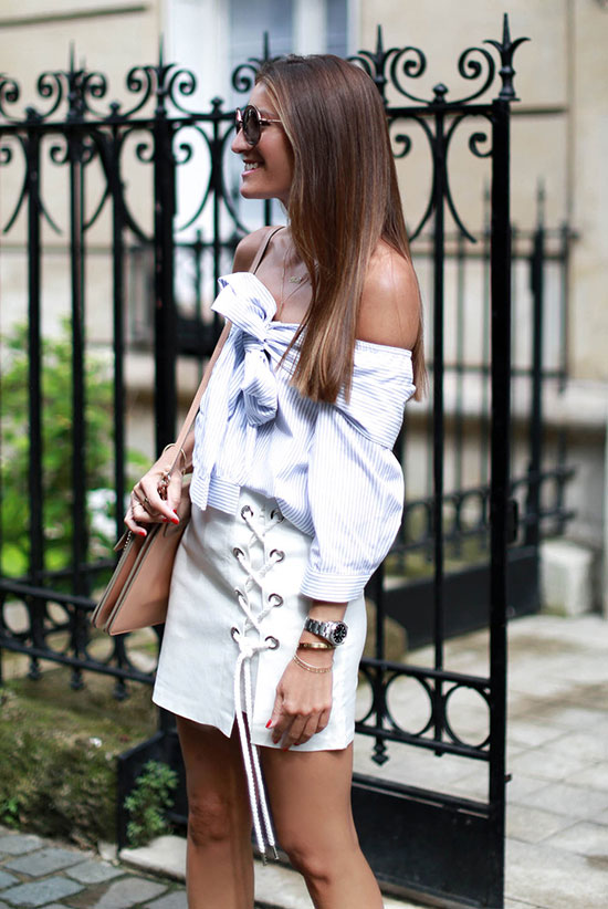 Summer Outfits - The Top Blogger Looks Of The Week: Fashion blogger 'Bartabac' wearing a blue stripe off the shoulder top, a white lace up mini skirt, nude lace up sandals, round sunglasses and a blush shoulder bag. Summer outfit, party outfit, night out outfit, street chic style, street style.