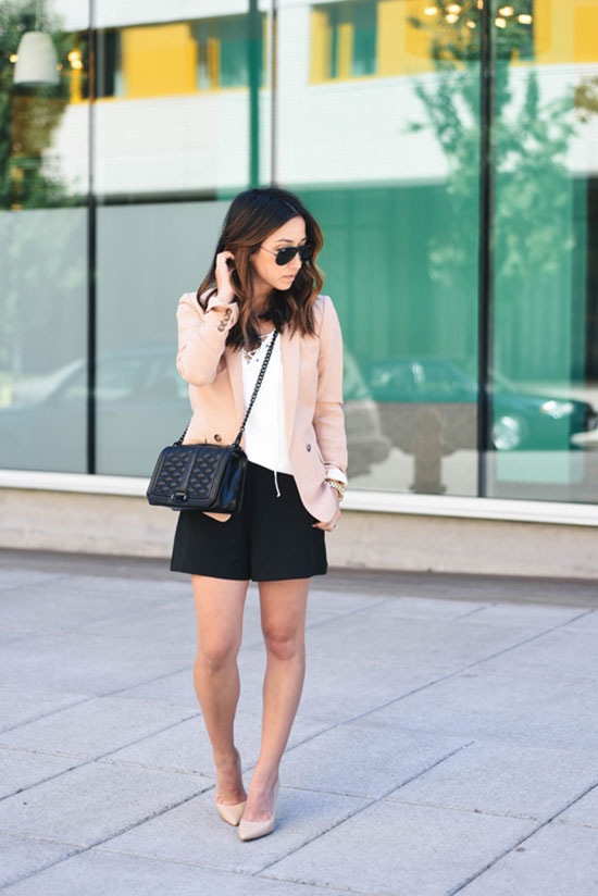 The Best Outfit Ideas Of The Week - Fashion blogger 'Crystalin Marie' wearing a white v-neck top, a blush blazer, black pleated shorts, nude heels, aviator sunglasses and a black shoulder bag. Summer outfit, spring outfit, night out outfit, casual outfit, party outfit, street style, street chic style.