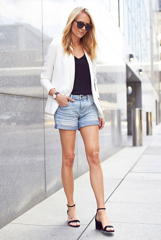 The Best Outfit Ideas Of The Week - Fashion blogger 'Fashion Jackson' wearing a black cami top, a white blazer, denim shorts, black heeled sandals and brown sunglasses. Summer outfit, spring outfit, casual outfit, night out outfit, black and white outfit, simple outfit, easy outfit, street style.