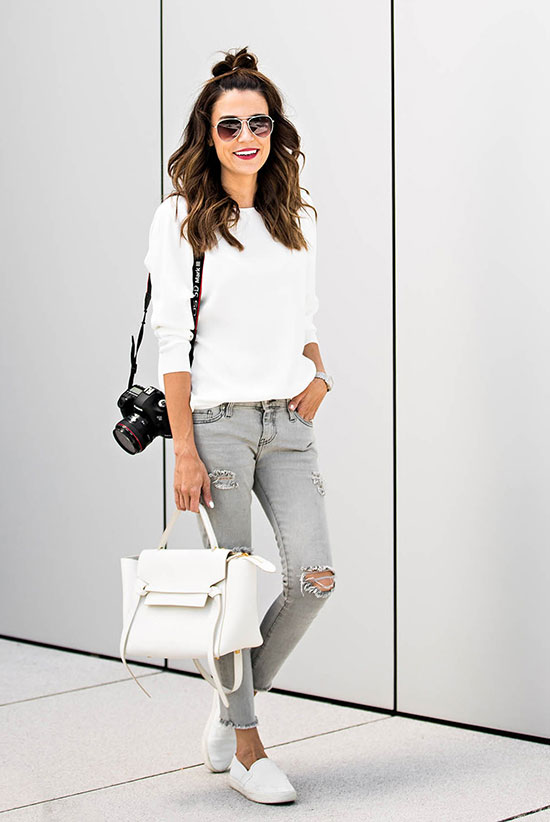 The Best Outfit Ideas Of The Week - Fashion blogger 'Hello Fashion Blog' wearing a white long sleeve t-shirt, light grey distressed skinny jeans, white sneakers, aviator sunglasses and a white handbag. Spring outfit, Fall outfit, casual outfit, simple outfit, neutral color outfit, easy outfit, comfy outfit, sneakers outfit, athleisure, street style.