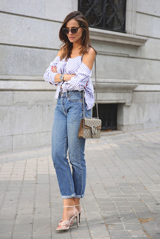 Summer Outfits - The Top Blogger Looks Of The Week: Fashion blogger 'Lady Addict' wearing a blue stripe cold shoulder top, mom jeans, nude heeled sandals, black sunglasses and a brown shoulder bag. Summer outfit, casual outfit, night out outfit, street chic style.