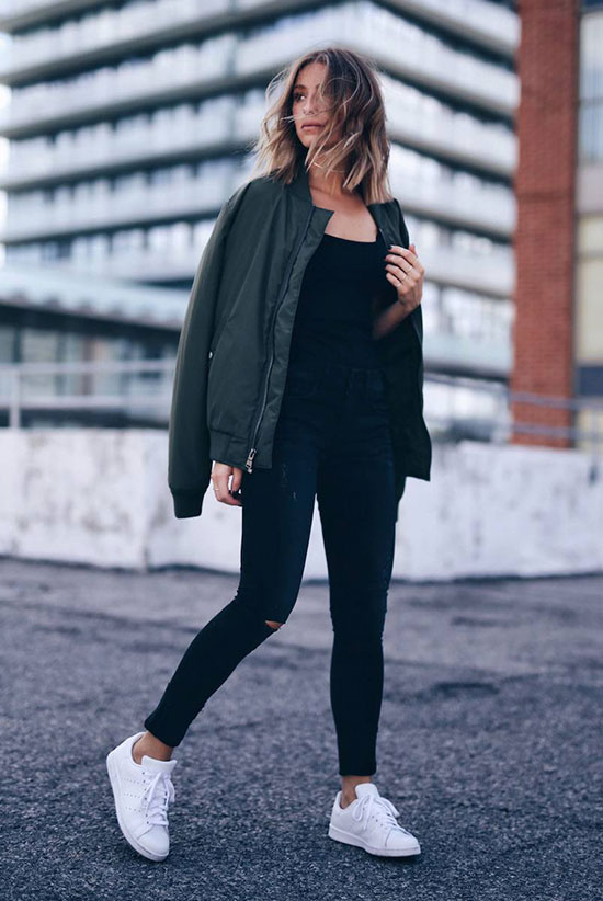 The Best Outfit Ideas Of The Week - Fashion blogger 'The August Diaries' wearing a military bomber jacket, a black t-shirt, distressed skinny jeans and white sneakers. Spring outfit, fall outfit, athleisure, casual outfit, comfy outfit, sporty outfit, game day outfit, comfy outfit, street style, fall trends 2016, spring trends 2016.