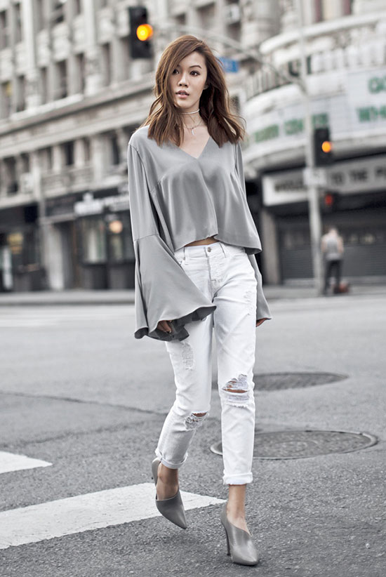 Summer Outfits - The Top Blogger Looks Of The Week: Fashion blogger 'Tsangastic' wearing a grey v-neck bell sleeve top, white distressed boyfriend jeans and grey pointy toe heels. Summer outfit, netural tone outfit, neutral color outfit, grey outfit, shades of grey outfit, night out outfit, casual outfit, monochrome outfit, street style.
