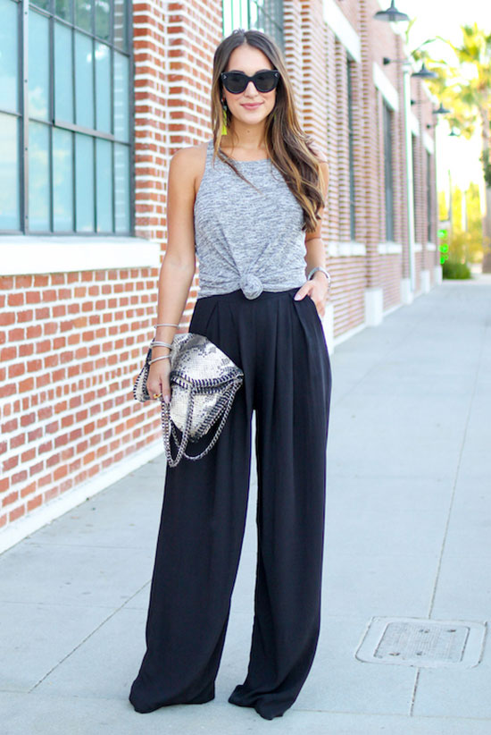 The Best Outfit Ideas Of The Week: Fashion blogger 'Carrie Bradshaw Lied' wearing a grey knotted tank top, black palazzo pants (black wide leg pants), black sandals, black sunglasses and a white shoulder bag. Summer outfit, simple outfit, night out outfit, comfy outfit, street chic style, summer trends 2016. Knottet t-shirt outfit, tie front top outfit.