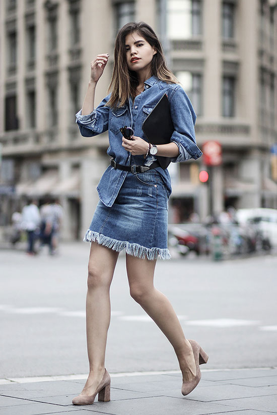 The Best Outfit Ideas Of The Week: Fashion blogger 'Fake Leather' wearing a denim shirt, a fringe hem denim mini skirt, a black double buckle belt, nude suede block heel pumps and a black clutch. Summer outfit, denim on denim outfit, night out outfit, comfy outfit, casual outfit, summer trends 2016, fall trends 2016.