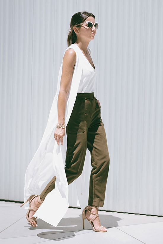 The Best Outfit Ideas Of The Week: Fashion blogger 'Lovely Pepa' wearing a light sleeveless long duster coat, a white v-neck muscle tee, khaki ankle pants, nude lace-up sandals and white cat eye sunglasses. Summer outfit, street chic style, casual outfit, night out outfit, summer trends 2016.
