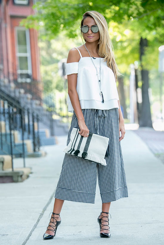 The Best Outfit Ideas Of The Week: Fashion blogger 'North Of Manhattan' wearing a white off the shoulder top, black gingham culottes, black lace-up heels, round mirror sunglasses and a stripe tassel clutch. Summer outfit, casual outfit, party outfit, night out outfit, street chic style, summer trends 2016.
