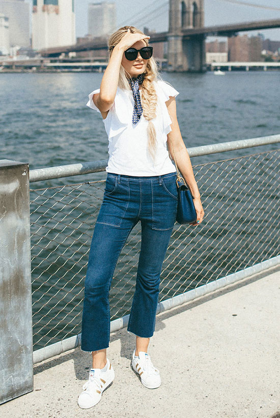 The Best Outfit Ideas Of The Week: Fashion blogger 'Barefoot Blonde' wearing a navy bandana, a white ruffle top, crop flare jeans, white sneakers, black sunglasses and a navy shoulder bag. Summer outfit, casual outfit, travel outfit, comfy outfit, weekend outfit, game day outfit, summer trends 2016, street style, athleisure outfit, sneakers outfit.