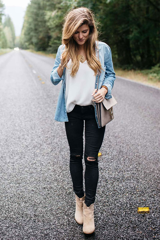 The Best Outfit Ideas Of The Week: Fashion blogger 'Brighton The Day' wearing a chambray shirt, a white cami top, black distressed skinny jeans, beige suede booties and a beige suede shoulder bag. Spring outfit, fall outfit, fall layers, casual outfit, boho outfit, boho chic outfit, booties outfit, street style.