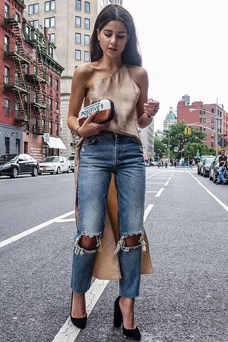 The Best Outfit Ideas Of The Week: Fashion blogger 'Haute Inhabitat' wearing a blush silk tunic, distressed crop jeans, black block heel pumps and a clutch. Summer outfit, night out outfit, party outfit, street style, street chic style, summer trends 2016.