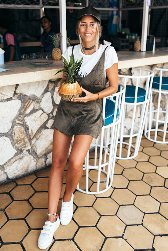 The Best Outfit Ideas Of The Week: Fashion blogger 'Janni Delér' wearing a white t-shirt, a khaki slip dress, white strap sneakers and a khaki baseball cap. Summer outfit, casual outfit, athleisure outfit, summer getaway outfit, summer vacation outfit, summer getaway outfit, summer trends 2016, street style, street chic style.