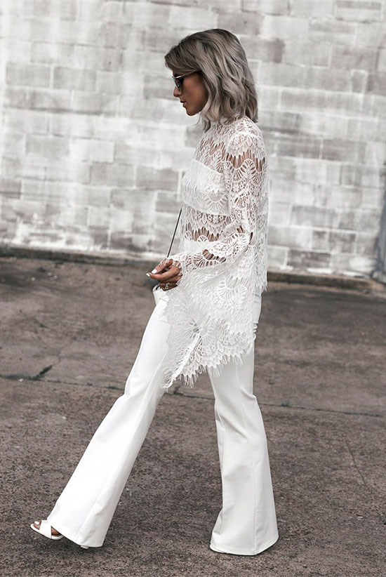 The Best Outfit Ideas Of The Week: Fashion blogger 'Jo & Kemp' wearing a white lace bell sleeve top, white flare pants, white block heel sandals, mirror sunglasses and a white shoulder bag. Summer outfit, party outfit, all white party outfit, all white outfit, night out outfit, street style, street chic style, summer trends 2016.