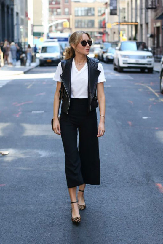 The Best Outfit Ideas Of The Week: Fashion blogger 'Memorandum' wearing a white t-shirt, a black leather vest, black culottes, leopard print heels and black sunglasses. Spring outfit, Fall outfit, casual outfit, night out outfit, party outfit, black and white outfit, street style.