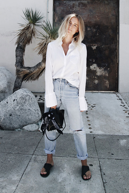 The Best Outfit Ideas Of The Week: Fashion blogger 'Mija Flatau' wearing a white shirt, light denim boyfriend jeans, black slide sandals, a black shoulder bag and a black bandana. Summer outfit, casual outfit, comfy outfit, black and white outfit, white shirt outfit, simple outfit, easy outfit, minimal outfit, street style, beach outfit, summer vacation outfit.