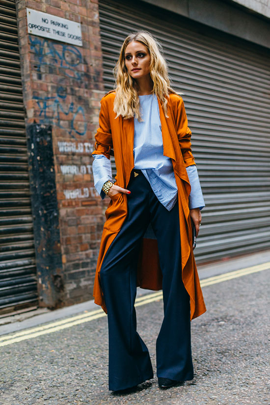 The Best Outfit Ideas Of The Week: Fashion blogger 'Olivia Palermo' wearing a blue stripe shirt, navy wide leg pants, black suede heels and an orange trench coat. Spring outfit, fall outfit, colorful outfit, business casual outfit, office outfit, work outfit, office wear, street style, fall layers, trench coat outfit.