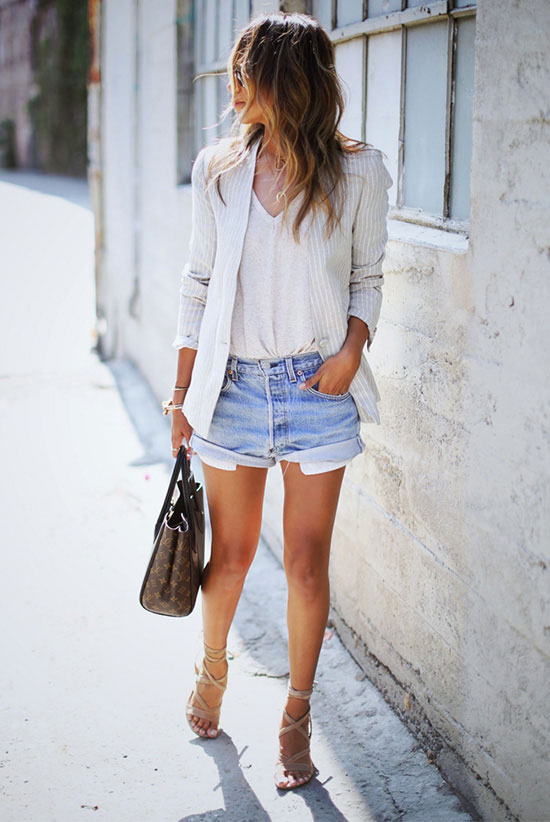 The Best Outfit Ideas Of The Week: Fashion blogger 'Sincerely Jules' wearing a beige stripe blazer, a white v-neck t-shirt, distressed denim shorts, beige lace up sandals, a brown logo bag and aviator sunglasses. Spring outfit, summer outfit, street chic style, casual outfit, night out outfit, street style.