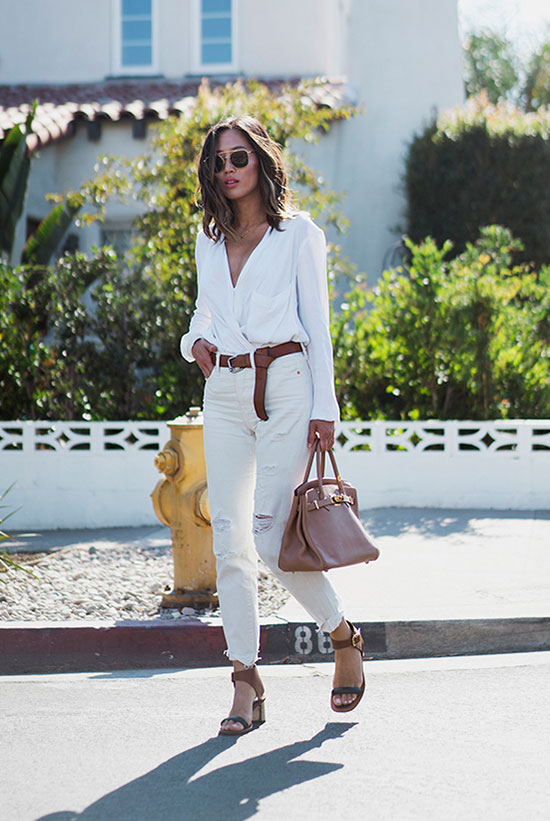 The Best Outfit Ideas Of The Week: Fashion blogger 'Song of Style' wearing a white blouse, a brown belt, white distressed boyfriend jeans, brown block heel sandals, metallic sunglasses and a brown handbag. Sumer outfit, spring outfit, all white outfit, neutral tone outfit, neutral color outfit, street style, street chic style, casual outfit.