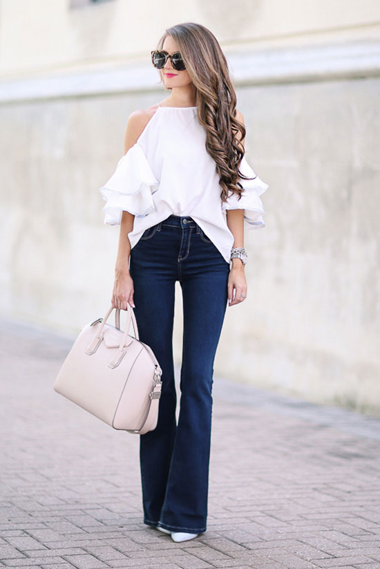 The Best Outfit Ideas Of The Week: Fashion blogger 'Southern Curls & Pearls' wearing a white cold shoulder top, flare jeans, white heels, brown sunglasses and a white handbag. Summer outfit, casual outfit, night out outfit, street chic style, cute outfit, flare jeans outfit, white outfit, summer trends 2016.