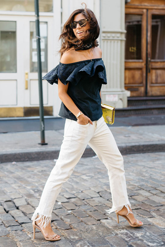 The Best Outfit Ideas Of The Week: Fashion blogger 'This Time Tomorrow' wearing a navy off the shoulder top, white fringe jeans, nude heeled sandals and black sunglasses. Summer outfit, casual outfit, night out outfit, street style, street chic style, summer trends 2016