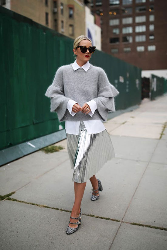 The Best Outfit Ideas Of The Week: Fashion blogger 'Atlantic-Pacific' wearing a white cuff sleeve shirt, a grey ruffle sleeve sweater, a silver pleated midi skirt, grey block heel pumps and brown cat eye sunglasses. Spring outfit, fall outfit, fall layers, all grey outfit, shades of grey outfit, neutral color outfit, neutral tone outfit, edgy outfit, street style, street chic style, holiday outfit, party outfit, night out outfit, fall trends 2016.
