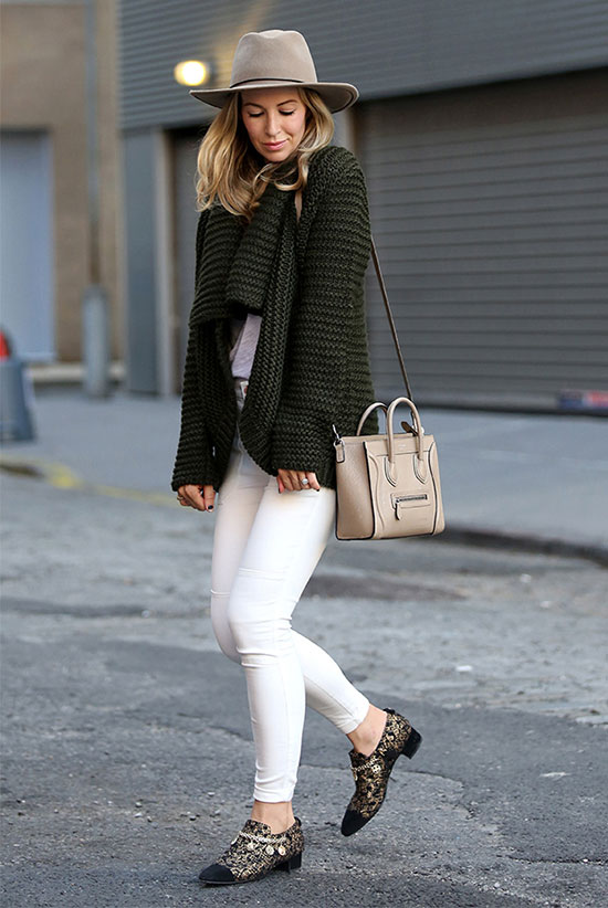 The Best Outfit Ideas Of The Week: Fashion blogger 'Brooklyn Blonde' wearing a beige fedora, a khaki oversized sweater, a grey t-shirt, white skinny jeans, leopard print oxfords and a beige shoulder bag. Fall outfit, winter outfit, casual outfit, street style, street chic style, comfy outfit.