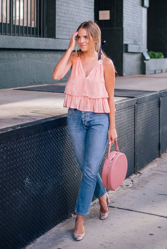The Best Outfit Ideas Of The Week: Fashion blogger 'Gal Meets Glam' wearing a pink velvet cami top, raw hem crop jeans, nude block heel pumps and a pink round bag. Spring outfit, summer outfit, street style, street chic style, casual outfit, night out outfit, cute outfit, summer trends 2016.