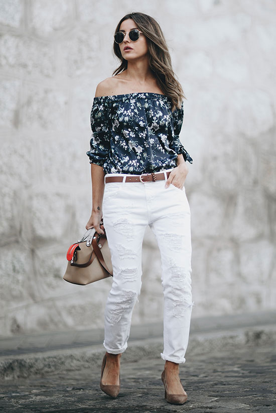 The Best Outfit Ideas Of The Week: Fashion blogger 'Lovely Pepa' wearing a navy floral print off the shoulder top, white boyfriend jeans, a brown skinny belt, taupe suede heels, round sunglasses and a beige shoulder bag. Spring outfit, summer outfit, casual outfit, night out outfit, cute outfit, street style, street chic style.