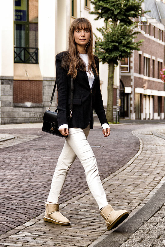 The Best Outfit Ideas Of The Week: Fashion blogger 'Mode Damour' wearing a black velvet blazer, a white t-shirt, beige skinny pants, beige ugg booties and a black shoulder bag. Fall outfit, winter outfit, casual outfit, work outfit, office outfit, comfy outfit, street style.