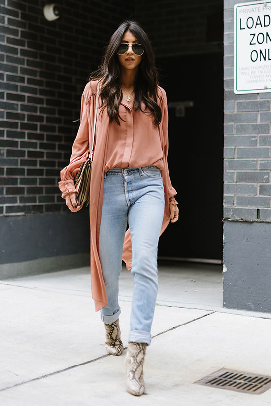 The Best Outfit Ideas Of The Week: Fashion blogger 'Not Your Standard' wearing a pink chiffon high low top, light was skinny jeans, snake booties, aviator sunglasses and a grey shoulder bag. Spring outfit, fall outfit, casual outfit, street style, street chic style.