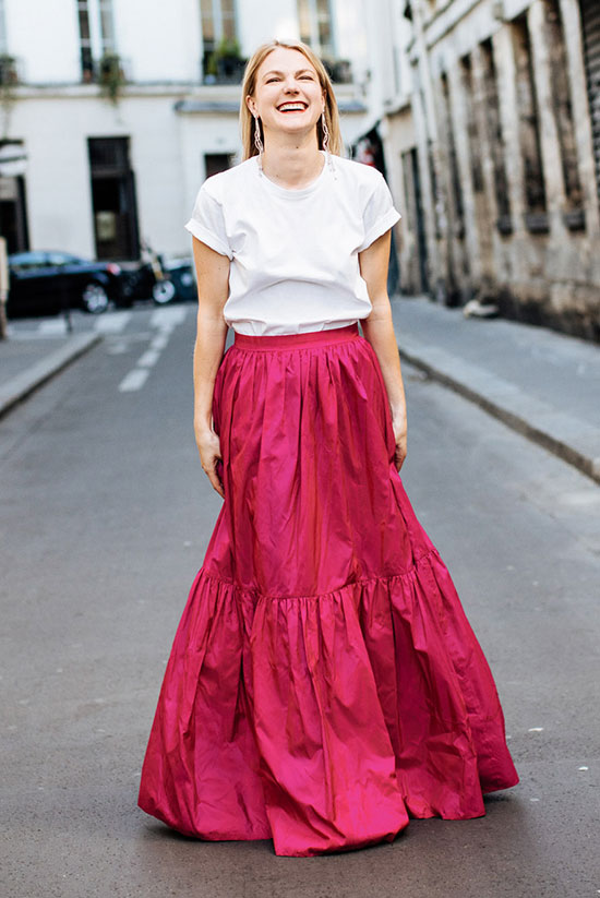 5 Casual Takes On The Pleated Skirt: Philippa Jenkings wearing a white t-shirt and a red pleated maxi skirt. Street style, street chic style, casual outfit, party outfit, pleated skirt outfit, maxi skirt outfit, minimal outfit, simple outfit, summer outfit, spring outfit, fall outfit, summer trends 2016, fall trends 2016.