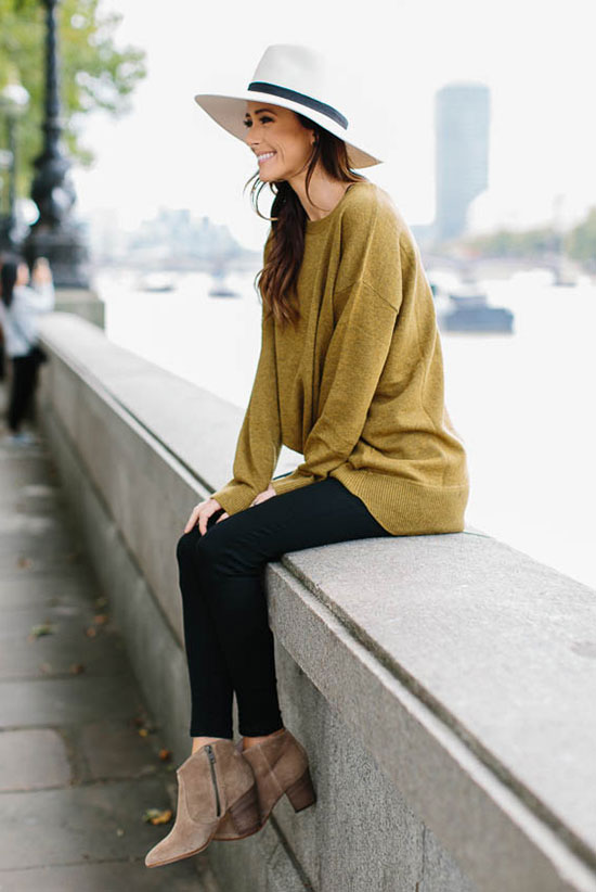 The Best Outfit Ideas Of The Week: Fashion blogger 'Sequins & Things' wearing a white fedora, a mustard yellow oversized sweater, black skinny jeans, brown booties and a brown handbag. Fall outfit, winter outfit, casual outfit, cute outfit, simple outfit, easy outfit, street style, street chic style.