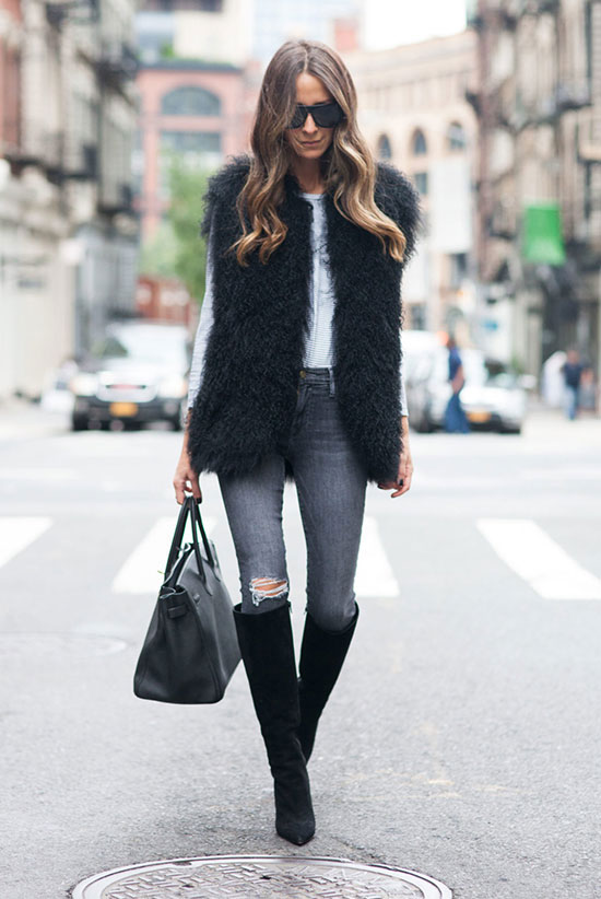 The Best Outfit Ideas Of The Week: Fashion blogger 'Something Navy' wearing a black fur vest, a white long sleeve t-shirt, dark grey skinny jeans, black suede knee high boots, black sunglasses and a black handbag. Fall outfit, winter outfit, street chic style, casual outfit, nigh out outfit, street style, black and white outfit, easy outfit.