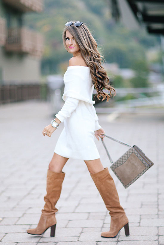 The Best Outfit Ideas Of The Week: Fashion blogger 'Southern Curls & Pearls' wearing a white off the shoulder sweater dress, brown heeled boots, black sunglasses and a brown logo shoulder bag. Fall outfit, spring outfit, holiday outfit, party outfit, nigh out outfit, casual outfit, street style, street chic style, fall trends 2016.