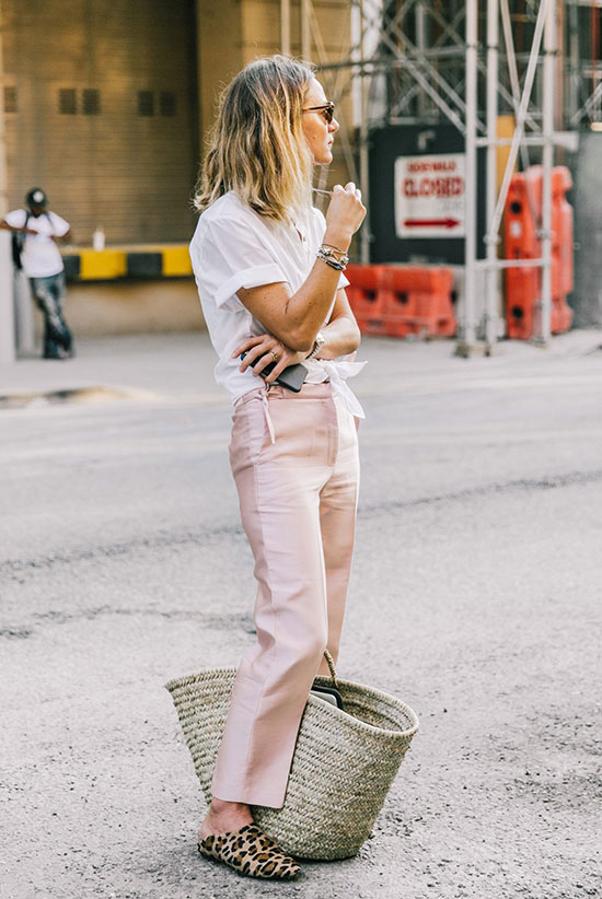 The Best Outfit Ideas Of The Week: Girl wearing a short sleeve tie front shirt, blush ankle pants, leopard print flat mules, round sunglasses and a straw tote bag. Spring outfit, summer outfit, casual outfit, comfy outfit, work outfit, office outfit, street style, street chic style, summer trends 2016.