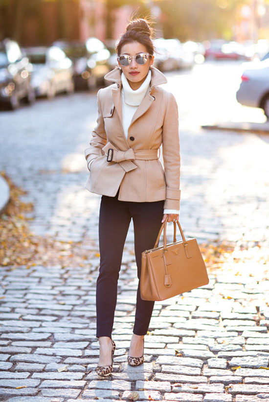 The Best Outfit Ideas Of The Week: Fashion blogger 'Extra Petite' wearing a beige short trench coat, a white turtleneck sweater, navy crop skinny pants, leopard print heels, a brown handbag and mirror sunglasses. Fall outfit, winter outfit, work outfit, office outfit, office wear, business casual, casual outfit, fall layers, street style, street chic style.