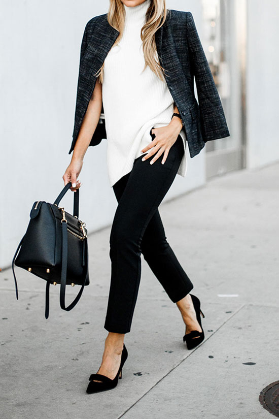 The Best Outfit Ideas Of The Week: Fashion blogger 'The Girl From Panama' wearing a black crop blazer, a white turtleneck sweater tunic, black crop pants, black suede bow heels and a black handbag. Fall outfit, spring outfit, work outfit, black and white outfit, office outfit, office style, business casual.