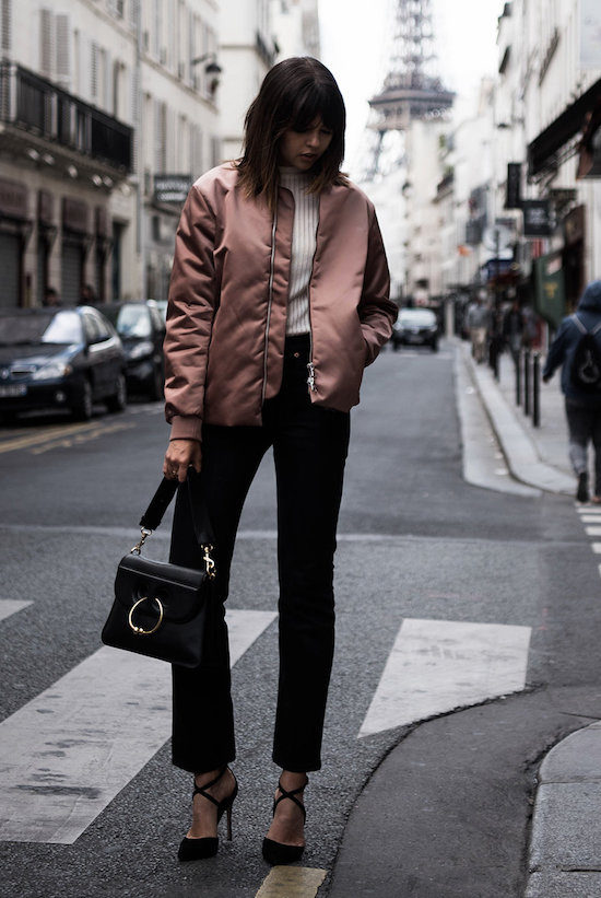 The Best Outfit Ideas Of The Week: Fashion blogger 'Badlands' wearing a pink bomber jacket, a white mock neck sweater, black crop jeans, black suede heels and a black handbag. Fall outfit, casual outfit, party outfit, night out outfit, work outfit, fall trends 2016, bomber jacket outfit.
