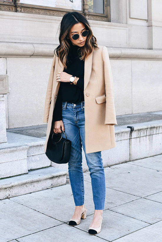 The Best Outfit Ideas Of The Week: Fashion blogger 'Crystalin Marie' wearing a camel coat, a black turtleneck sweater, raw hem straight jeans, bicolor heels, round sunglasses and a black handbag. Fall outfit, winter outfit, work outfit, simple outfit, easy outfit, camel coat outfit, street style, street chic style, casual outfit, night out outfit.