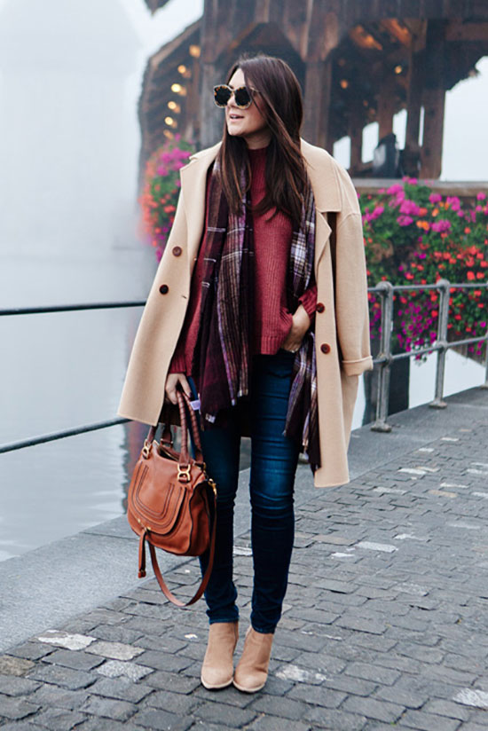 The Best Outfit Ideas Of The Week: Fashion blogger 'Kendi Every Day' wearing a camel coat, a burgundy plaid scarf, a burgundy sweater, skinny jeans, nude pointy toe booties, brown sunglasses and a brown handbag. Winter outfit, winter layers, cold weather outfit, cozy outfit, camel coat outfit, casual outfit, nigh out outfit.