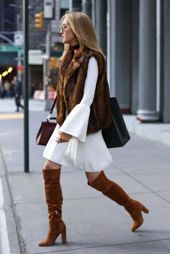 The Best Outfit Ideas Of The Week: Fashion blogger 'Memorandum' wearing a brown fur vest, a white bell sleeve dress, brown suede over the knee boots, round sunglasses and a burgundy shoulder bag. Fall outfit, spring outfit, casual outfit, night out outfit, fur vest outfit, over the knee boots outfit, street chic style, fall trends 2016.