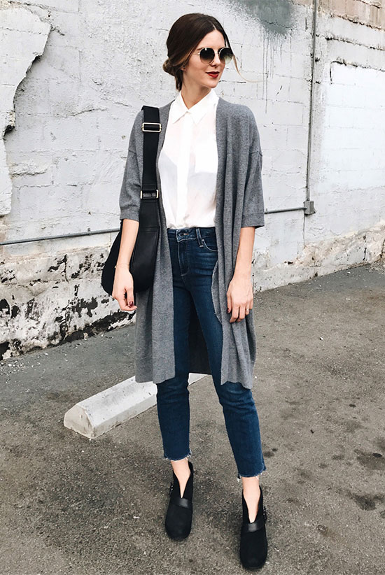 The Best Outfit Ideas Of The Week: Fashion blogger 'Take Aim' wearing a grey cardigan, a white shirt, raw hem crop jeans, black suede booties, round sunglasses and a black hobo bag. Fall outfit, spring outfit, simple outfit, easy outfit, fall layers, cardigan outfit, street style, work outfit.