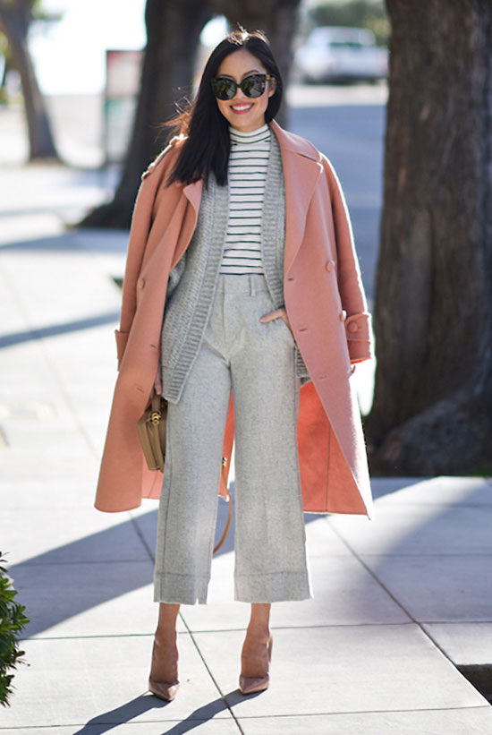20 Cute Valentine's Day Outfits For Every Situation: Fashion blogger '9 to 5 Chic' wearing a pink coat, a grey cardigan, a stripe turtleneck t-shirt, grey culottes, nude heels and a nude shoulder bag. Fall outfit, winter outfit, fall layers, winter layers, work outfit, office outfit, office wear, business casual, valentine's day outfit, casual valentine's day outfit, office valentine's day outfit.