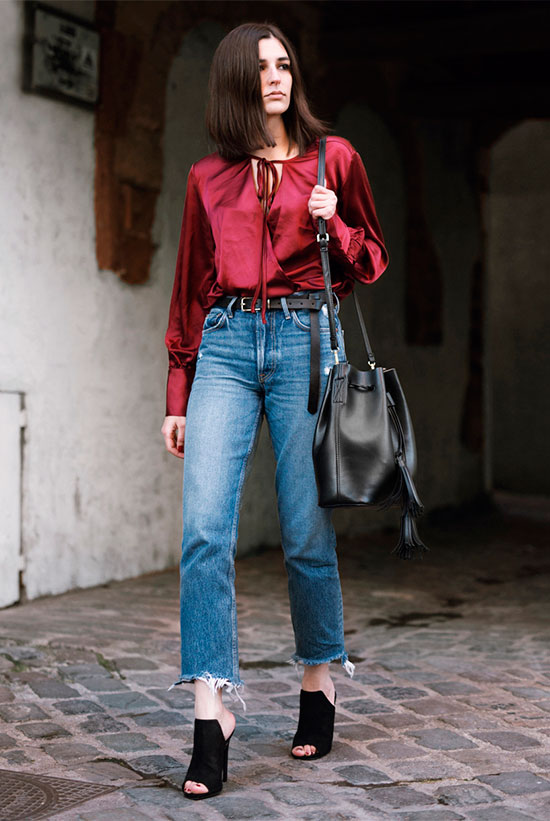 20 Cute Valentine's Day Outfits For Every Situation: Fashion blogger 'Aria di Bari' wearing a burugundy blouse, a black belt, crop jeans, black mules and a black shoulder bag. Spring outfit, fall outfit, holiday outfit, casual holiday outfit, valentine's day outfit, casual valentine's day outfit, night out outfit, street style.